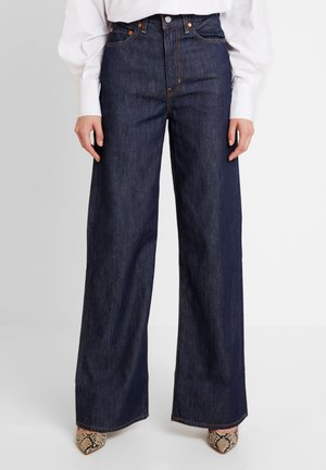 RIBCAGE WIDE LEG - Flared Jeans - high and mighty