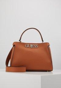 Guess - UPTOWN CHIC TURNLOCK SATCHEL - Handbag - cognac - 0