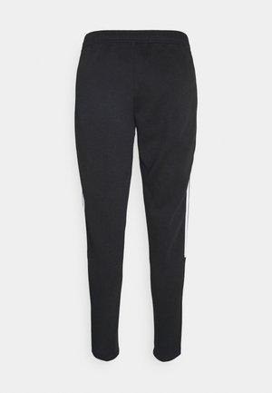 TIRO - Pantalones deportivos - black