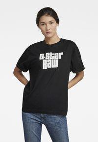 G-Star - UNISEX RADIO BOXY R T - Print T-shirt - dry jersey o - dk black - 1