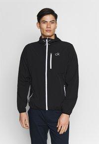 Calvin Klein Golf - ULTRALITE JACKET - Verryttelytakki - black - 0