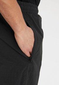 Urban Classics - CRINKLE TRACK PANTS - Tracksuit bottoms - black/white/ultraviolet - 5