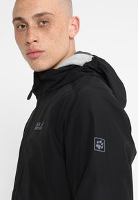 Jack Wolfskin - STORMY POINT JACKET  - Waterproof jacket - black - 5