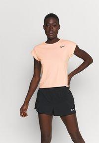 Nike Performance - T-shirts - arctic orange - 0
