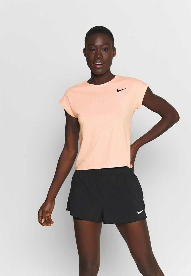 Nike Performance - T-shirts - arctic orange
