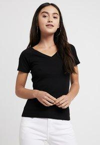ONLY Petite - ONYLABELLA V NECK - Basic T-shirt - black - 0