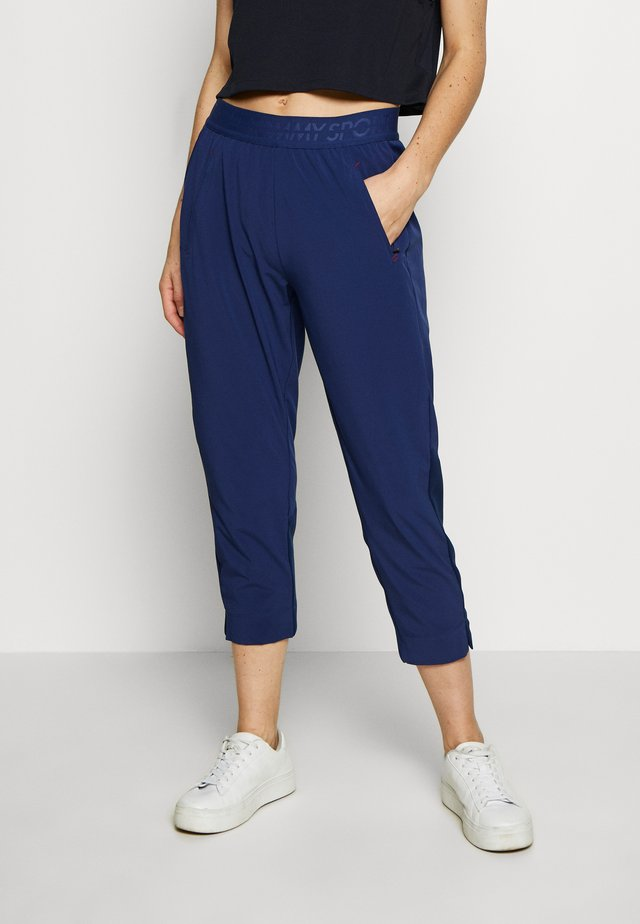 7/8 RUNNING TECH PANT - Tracksuit bottoms - blue