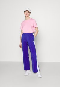 Fila - ALKAS TRACK PANT - Trousers - clematis blue/bright white - 1
