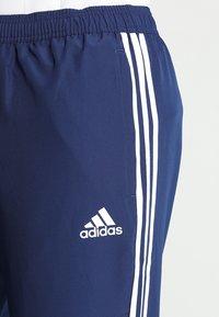 adidas Performance - TIRO 19 - Tracksuit bottoms - darkblue/white - 5
