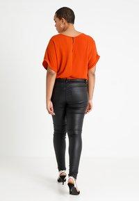 ONLY Carmakoma - CARPUNK SKINNY BIKER COATED  - Trousers - black - 2