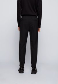 BOSS - Tracksuit bottoms - black - 2