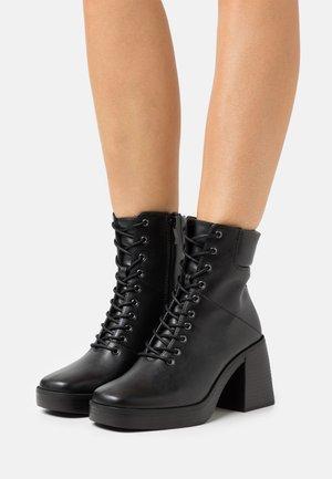 ALMAH - Lace-up ankle boots - black