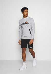 Ellesse - ASTERO SHORT - Sports shorts - black - 1