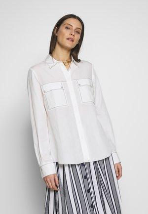 BASTIEN - Button-down blouse - milchweiß