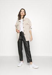 Vila - VIPIPPA COATED DETAIL PANTS - Trousers - black - 1