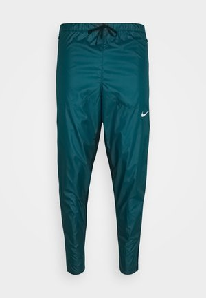 SHIELD - Tracksuit bottoms - dark teal green/black/silver