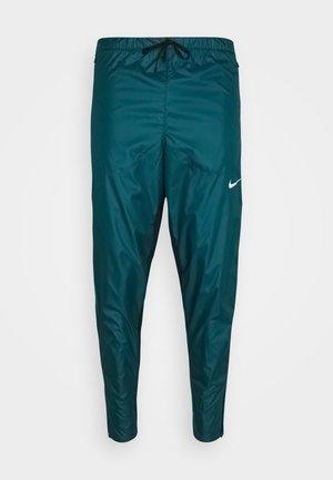 SHIELD - Pantalones deportivos - dark teal green/black/silver