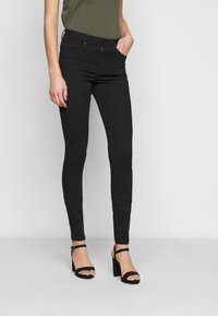 Vero Moda Tall - VMTANYA PIPING RAW - Jeans Skinny Fit - black - 0