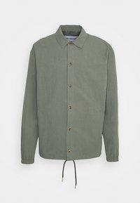 Han Kjøbenhavn - COACH JACKET - Summer jacket - army - 0