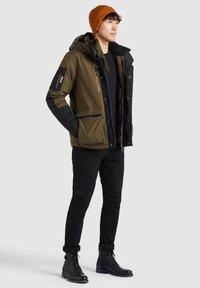khujo - NANDU - Winter jacket - oliv-schwarz kombo - 5
