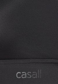 Casall - CROSSBACK  - Medium support sports bra - black - 5
