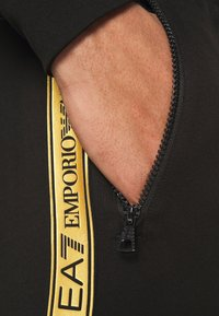 EA7 Emporio Armani - Tracksuit bottoms - black/gold - 4