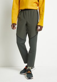adidas Performance - Tracksuit bottoms - legear - 0