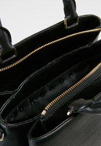 DKNY - MEDIUM SATCHEL - Handbag - black/gold - 4