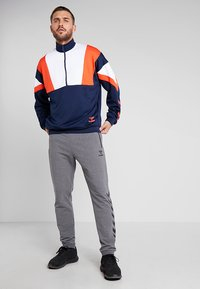 Hummel - RAY - Tracksuit bottoms - dark grey melange - 1
