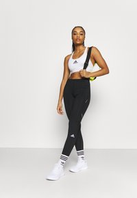 adidas Performance - HOW WE DO - Leggings - black/grey six