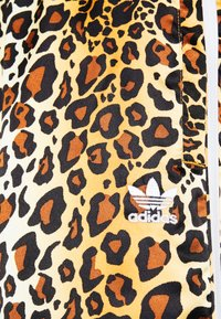 adidas Originals - LEOPARD PANT - Tracksuit bottoms - multco/mesa - 5