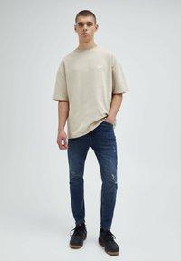 PULL&BEAR - Slim fit jeans - mottled dark blue - 1