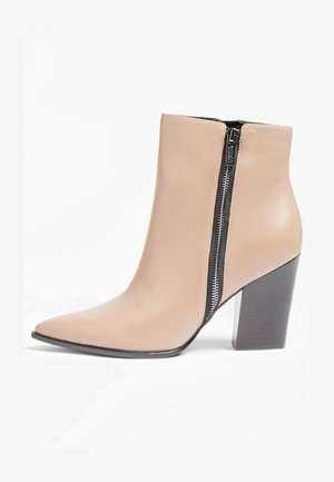 JAKIRA - Classic ankle boots - beige