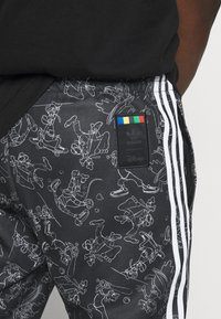 adidas Originals - GOOFY - Tracksuit bottoms - black/white - 4