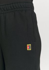 Nike Performance - HERITAGE PANT - Tracksuit bottoms - black - 4