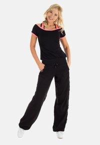 Winshape - Outdoor trousers - schwarz - 5