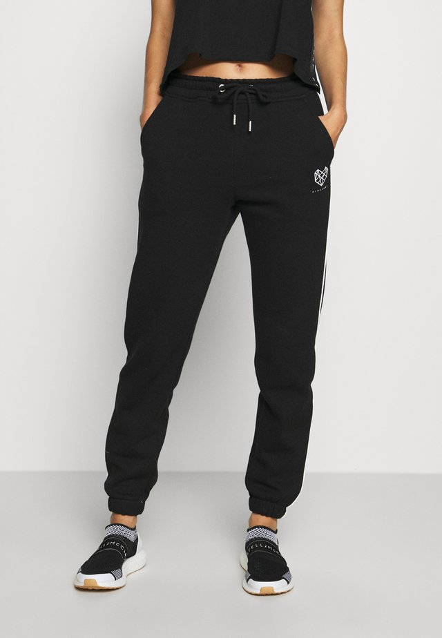 BREEZE JOG PANT - Verryttelyhousut - black/lilac