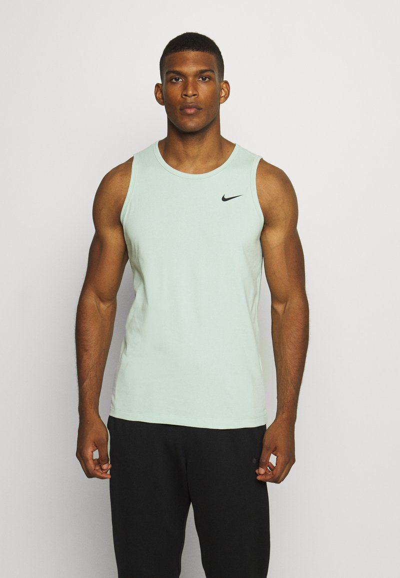 Nike Performance - DRY TANK SOLID - Sports shirt - pistachio frost