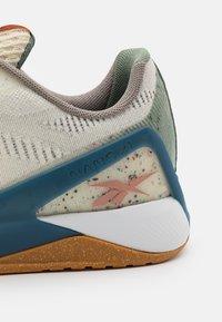Reebok - NANO X1 GROW - Sports shoes - classic white/harmony green/brave blue - 5