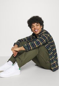 Dickies - MILLERVILLE - Cargo trousers - military green - 3