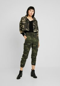 Hollister Co. - ULTRA HIGH RISE JOGGER - Trousers - olive - 2