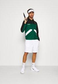 Lacoste Sport - TRACK JACKET - Training jacket - black/bottle green/white - 1
