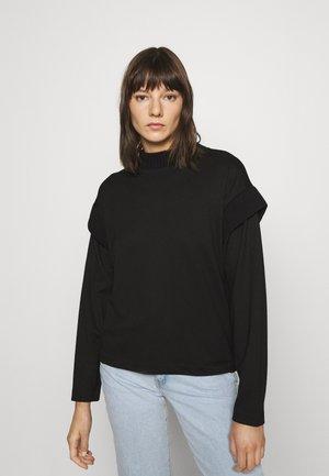 UNILDA - Long sleeved top - black