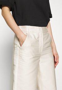 DESIGNERS REMIX - HAILEY FLARE - Trousers - cream - 6