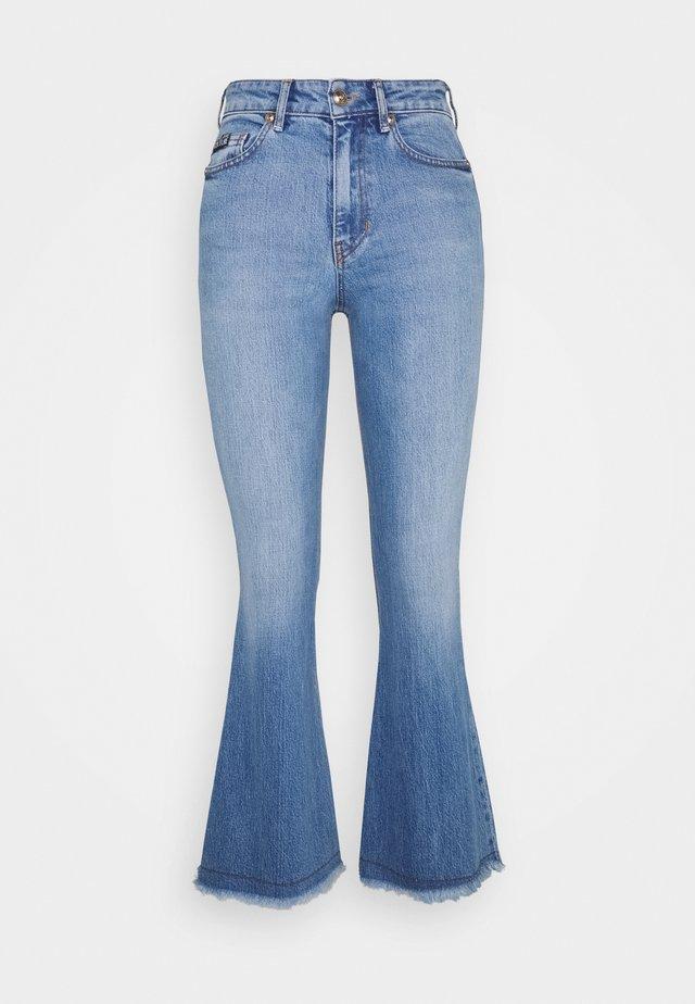 Jeans a zampa - indigo