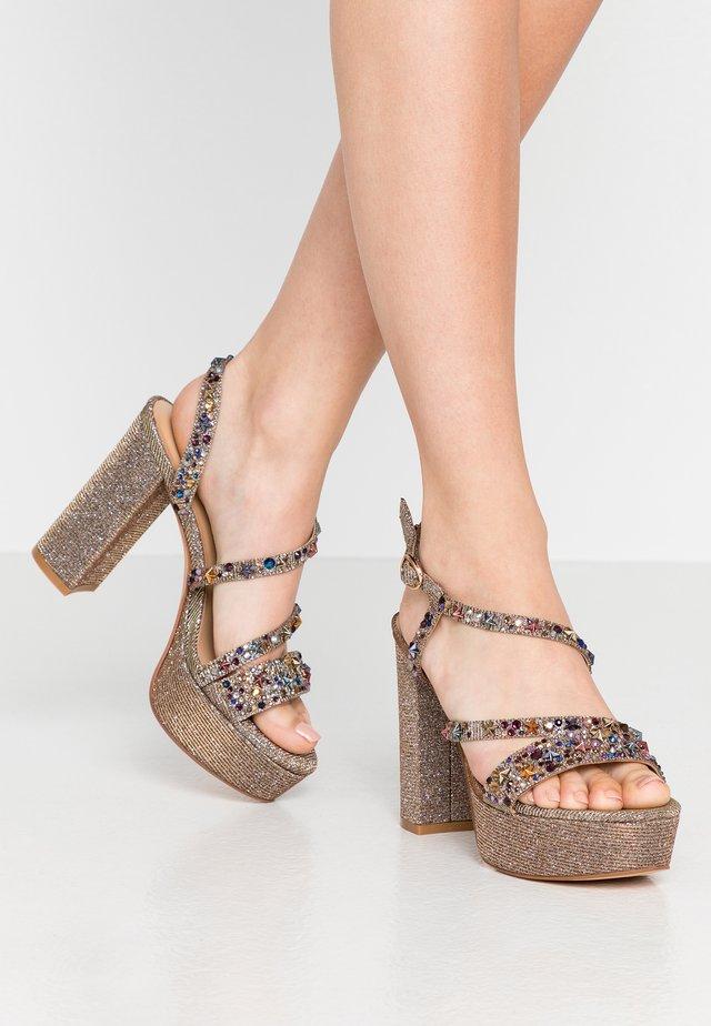 High heeled sandals - noir/bronze
