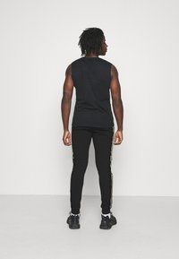 Glorious Gangsta - BARCO - Tracksuit bottoms - black/gold - 2