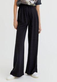PULL&BEAR - RUSTIKALE - Trousers - black - 0