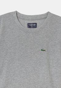 Lacoste Sport - LOGO UNISEX - Basic T-shirt - silver - 2
