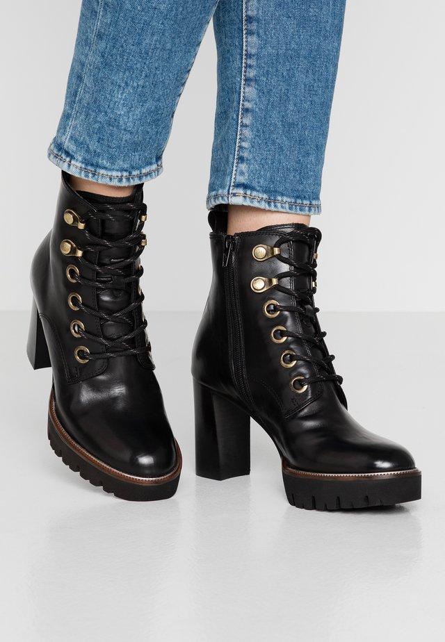 High heeled ankle boots - touareg nero